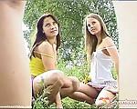 Two teenage girls posing