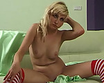 Blonde teen enjoying her body
