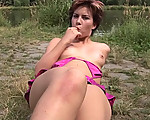 Dildo fun in the grass
